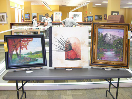 Three painting on display at the 2015 Senior Citizen Artshow held at the Ventnor Library.