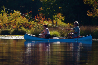 Two people enjoy fishing on Atlantic County Park at Lake Lenape